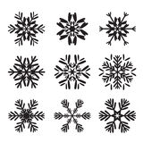 Set of black snowflakes Stock Photos