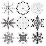 Set of 9 black snowflakes. On a white background Royalty Free Stock Photos