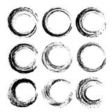 Set of black textured circle strokes Stock Images