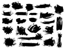 Set of bushy black brushstrokes. Set of black vector bushy brush strokes on white background. Painted grunge stripes and blobs Royalty Free Stock Photos