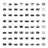 Set of black vector crowns Stock Photos