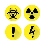 Set of black warning signs on the yellow, silhouettes. Vector illustration. Set of vector flat warning signs on the yellow background and with shadows Stock Photos