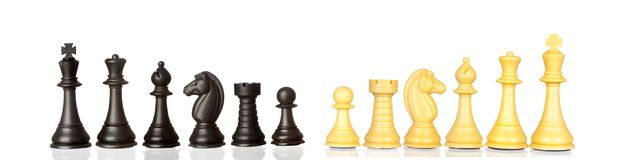 Set of black and white chess pieces. Isolated on a white background Royalty Free Stock Image