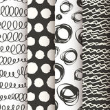 Set of 4 black and white doodle seamless patterns Royalty Free Stock Photography