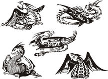 Set of black and white dragons. Set of black and white powerful dragons. Vector illustration Royalty Free Stock Image