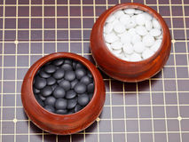 Set of black and white go game stones Stock Photo