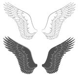 Set of black and white illustrations with wings. Royalty Free Stock Image