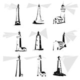 Set of black and white lighthouse icons. Royalty Free Stock Images