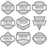 Set of black and white ornate labels on white background. royalty free illustration