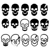 A set of black and white simple skulls. Fifteen various vector illustrations of skulls for the cutting of a plotter, embossing, engraving, etc Royalty Free Stock Images