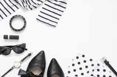 Set of black and white woman clothes and accessories. On white background. Top view point, flat lay Royalty Free Stock Photo