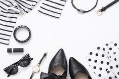 Set of black and white woman clothes and accessories. On white background. Top view point, flat lay Stock Photo