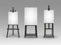 Set of Black Wooden Easels with Blank Canvases Royalty Free Stock Image