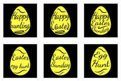 A set of black and yellow easter eggs decorated with text Royalty Free Stock Photos