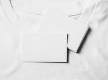 Set of blank business cards on white tshirt Royalty Free Stock Photos