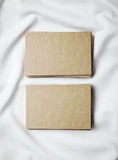 Set of blank craft business cards on white tshirt Royalty Free Stock Photo