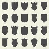 Set of blank empty dark shields. Shield badge Stock Photo