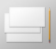 Set of Blank Envelopes with Yellow Pencil on Gray Background. Stock Photography