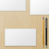 Set of blank envelopes with yellow pencil and pen on wooden back Royalty Free Stock Photography
