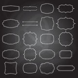 Set of blank retro vintage frames on chalkboard Stock Images