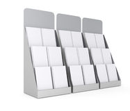Set of blank stands with magazines. Three blank stands with magazines in a row Royalty Free Stock Photo