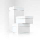 Set of Blank White Carton boxes of different sizes and shapes in Perspective for package design on White Background. Vector Set of Blank White Carton boxes of Royalty Free Stock Photography
