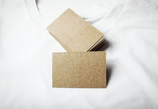Set of blanks craft business cards on white tshirt Royalty Free Stock Photo