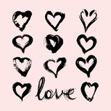 A set of blots of the spots of hearts painted with a brush. With the inscription love. The vector image Stock Photography