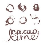 A set of blots of stains from a cup with an inscription of cocoa time. Royalty Free Stock Photography