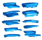 Set of blue gouache brush strokes. Set of blue abstract gouache brush strokes on a white background Royalty Free Stock Image