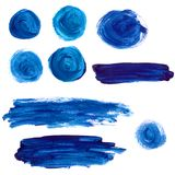 Set of blue acrylic paint stains and strokes. Royalty Free Stock Photos