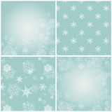 Set of blue backgrounds with snowflakes. Set of 4 blue backgrounds with snowflakes. Vector illustration. Two backgrounds are seamless patterns, and the other Royalty Free Stock Images