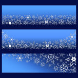 Set of blue banners with 3d white ornate snowflakes. Set of trendy horizontal banners with 3d white ornate snowflakes isolated. Christmas and New Year card Stock Photography
