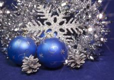 Set blue beautiful glass New Year`s balls, brilliant tinsel,   on a blue background - New Year`s composition, a card.  Royalty Free Stock Photo