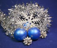 Set blue beautiful glass New Year`s balls, brilliant tinsel,   on a blue background - New Year`s composition, a card.  Stock Images
