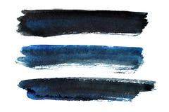 Set of blue-black brush strokes Royalty Free Stock Images