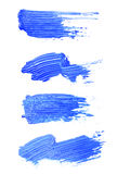 Set of blue brush strokes of acrilic paint as sample of art product Stock Images