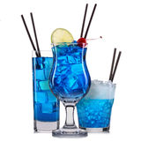 Set of blue cocktails with decoration from fruits and colorful straw isolated on white background Stock Photos