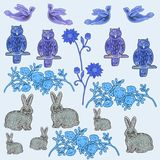 Set of blue color from figures of hares, owls, birds, bushes of roses and a flowers. royalty free illustration