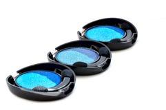 Set of blue eyeshadow. Isolated on white Stock Photography