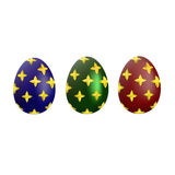 A set of blue, green and red Easter eggs with a gold pattern. On a white background Royalty Free Illustration