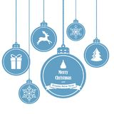 Set of blue hanging christmas balls with symbols such as snowflake, reindeer, gift and Christmas tree. On white background Royalty Free Stock Photo