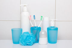 Set of blue hygiene supplies over tiled wall Royalty Free Stock Photography