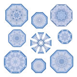 Set of blue polygonal snowflakes on white, in vector Royalty Free Stock Image