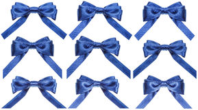 Set of blue satin bows isolated on white Royalty Free Stock Photography