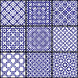 A set of blue seamless geometric patterns. Vector illustration Stock Photos