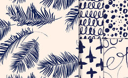 Set of blue seamless patterns drawn with dry brush. Palm leaves, stocks, spots, net Stock Photo