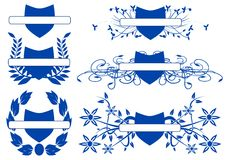 Set of blue shields with floral decorations isolated Stock Photos