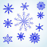 Set blue snowflakes doodle. Christmas symbol. Vector Royalty Free Illustration