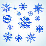 Set blue snowflakes doodle. 14 pieces. vector Royalty Free Illustration